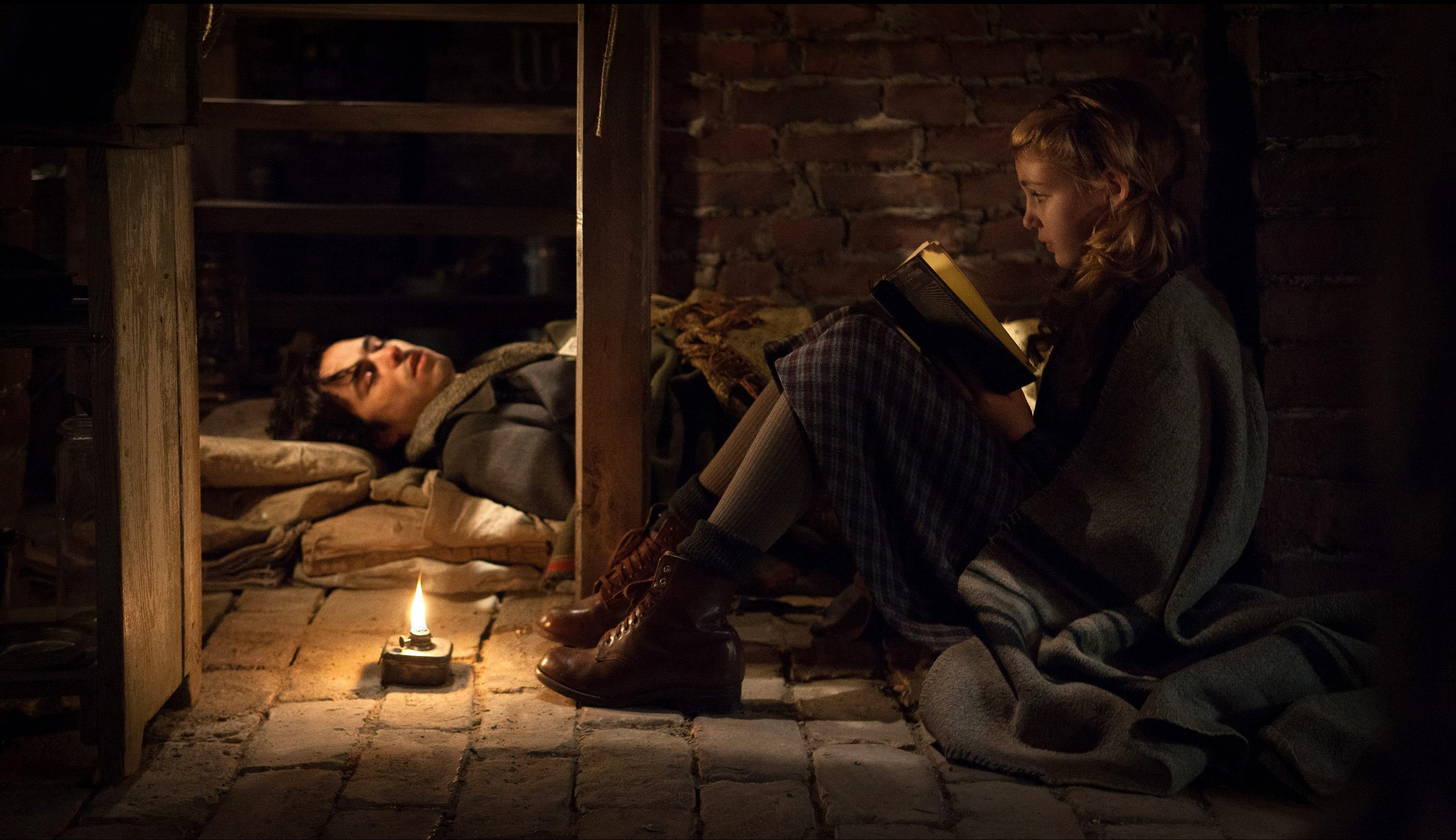 "This image released by 20th Century Fox shows Ben Schnetzer, left, and Sophie Nélisse in a scene from ""The Book Thief,"" about a girl who loves books. (AP Photo/20th Century Fox, Jules Heath) ORG XMIT: NYET714"